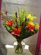 Iris, lillies, solidago, alstroemeria, and kangaroo
