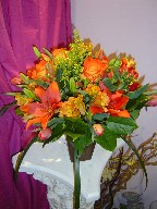 Roses, coffee beans, solidago, alstroemeria, lillies, tulips, and monkey grass