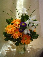 Gerbera, iris, aster, and monkey grass