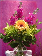 Gerbera, lillies, stocks, and solidago