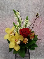 Cymbidium orchids, rose, snapdragons, and alstroemeria