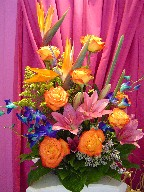 Bird of paradise, solidago, dendrobium orchids, sunshine roses and asiatic lilies