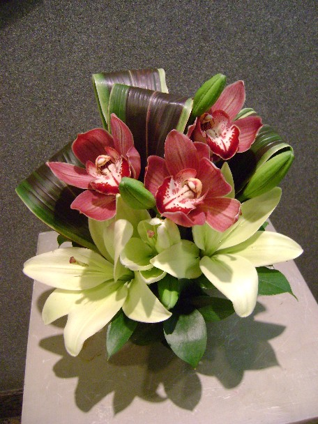 Cymbidium orchids, lilies, and cordeline