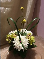 Cymbidium orchids, commercial mum, variegated pitt, crespedia, and monkey grass