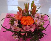 Asiatic lillies, circle roses, alstroemeria, daisies, and wax flowers