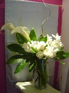 Calla lillies, roses, dendrobium orchids, and fatsia japonica