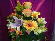 Alstroemeria, lillies, roses, gerbera, coffee beans, and solidago