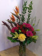 Gerbera, commercial mum, asiatic lillies, leucadendron, alstroemeria, myrtle, and thlaspia