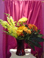 Snapdragon, gerbera, daisies, pompoms, and fatsia