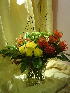 Protea, roses, alstroemeria, pompoms, and steel grass