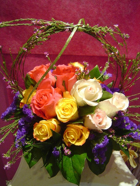 Roses, statice, and waxflowers