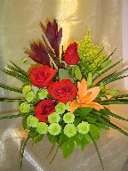 Roses, lillies, solidago, eucadendron, and pompoms