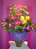Roses, bouvardia, monte casino white, waxflowers, orchids, and gerbera