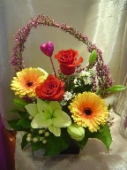 Roses, gerberas, lillies, hypericum, daisies, and heather