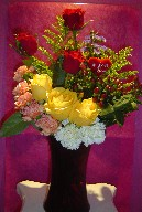 Roses, solidago, coffee beans, monte casino blue, and carnations