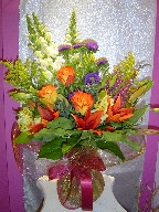 Aster, solidago, snapdragon, roses, alstroemeria, and heather