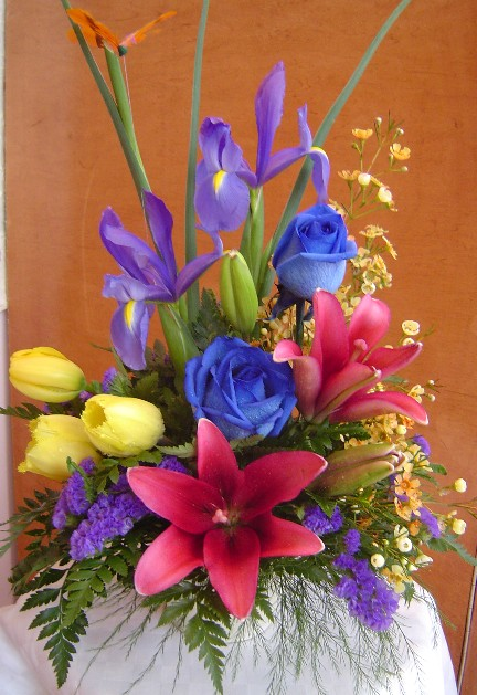 Tulips, iris, roses, lilies, waxflowers, and statice