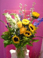 Sunflowers, delphinium, roses, snapdragon, solidago, iris, and monkey grass