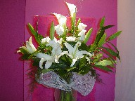Casablanca, calla lillies, vendela roses, berries, and freesia