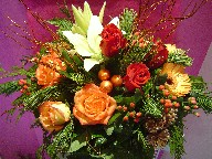 Lillies, berries, gerbera, roses, pine, cones, Christmas branch and decorations
