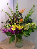 Bells of Ireland, bird of paradise, dendrobium orchids, cymbidium orchids, thistle, asiatic lillies, and dianthus