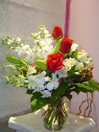 Roses, dendrobium orchids, alstroemeria, berries, lillies, and stock