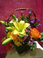 Lillies, monte casino blue, carnations, waxflowers, daisies, and roses