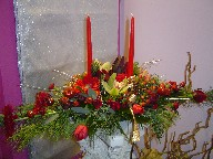 Cymbidium orchids, lillies, gerbera, roses, tulips, coffee beans, pine, pine cones, seed eucalyptus, cedar, and Christmas ornaments