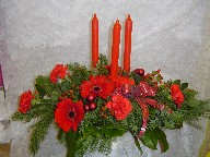 Gerbera, carnations, hypericum, pine, and Christmas decorations