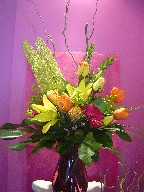 Roses, eremurus, tulips, gerbera, lillies, curly willow, waxflowers, solidago, monstera, and monkey grass