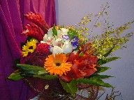 Gerbera, lillies, celosia, roses, alstroemeria, ginger, lisianthus, orchids, and sunflowers