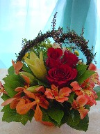 Roses, lillies, alstroemeria, monkara orchids, daisies, and thryptomene