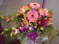 Gerbera, roses, dendrobium orchids, lillies, alstroemeria, and pine