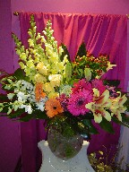 Snapdragon, gerbera, monstera, shocking lillies, roses, coffee beans, dendrobium orchids, and floral cabbage