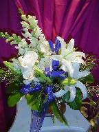 Roses, snapdragon, lillies, alstroemeria, and thryptomene