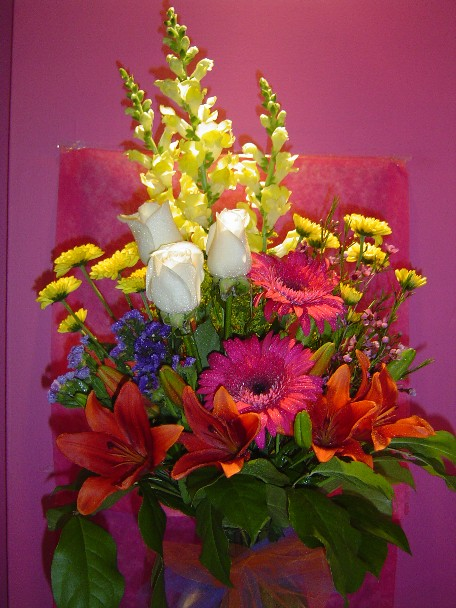 Roses, snapdragon, gerbera, lilies, daisies, and monte casino blue