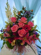 Snapdragon, coffee beans, roses, lillies, gerbera, alstroemeria, iris, solidago, and monte casino blue