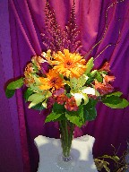 Roses, lillies, gerbera, astilbe, and curly willow