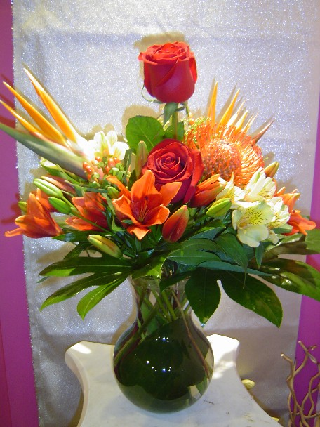 Roses, alstroemeria, bird of paradise, pin cushion, lillies, and hypericum